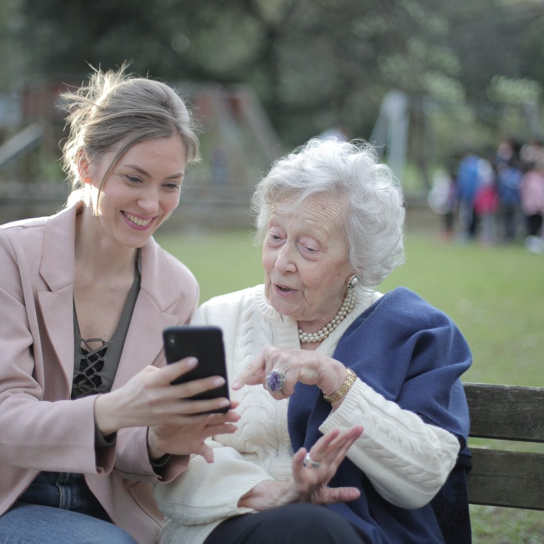 AmberPersonalCare-Stock-cheerful-senior-mother-and-adult-daughter-using-smartphone-3791664