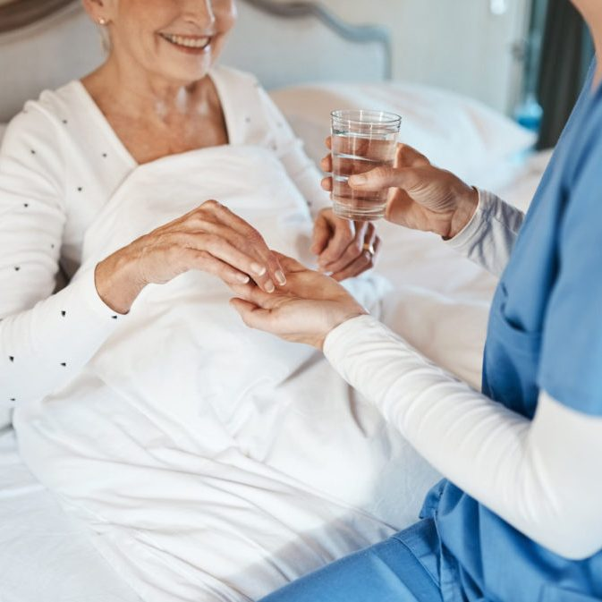 caregiver giving water